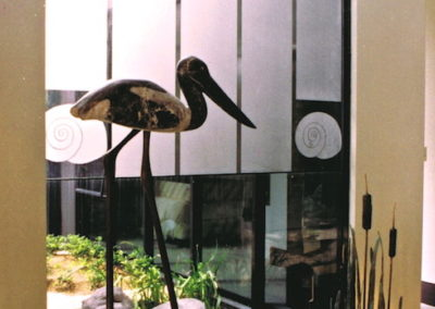 1992 Bulrush Visitors. Chillagoe Marble Jabiru with Bronze legs.  Bronze Bulrushes on sandstone base with river rocks