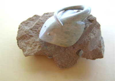 2009 Longtailed Ray. Silkwood Soapstone and Saraji Sandstone base. 34cm long